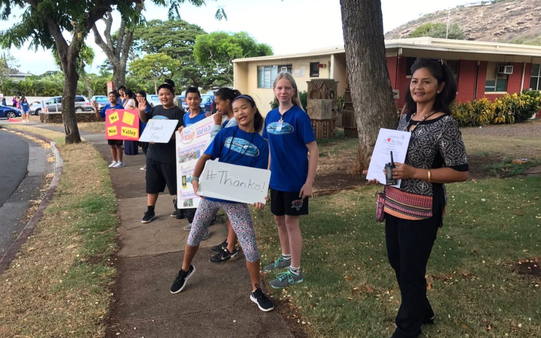 Sign Waving for We Love Niu Valley