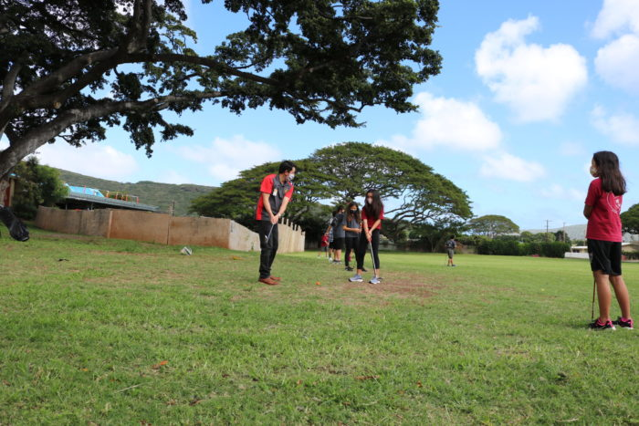 Students getting golf lessons