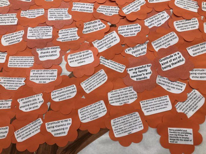 Message of gratitude on floral shaped orange construction paper