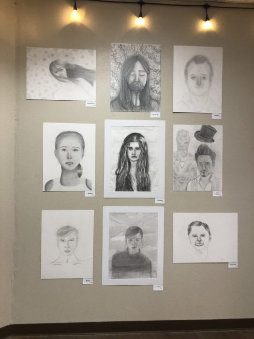9 artworks of pencil drawings on the wall